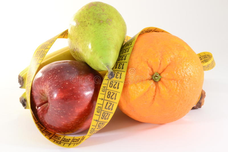 Fruits and meter, diet concept. Fresh orange, pear, apple and meter, diet concept royalty free stock images