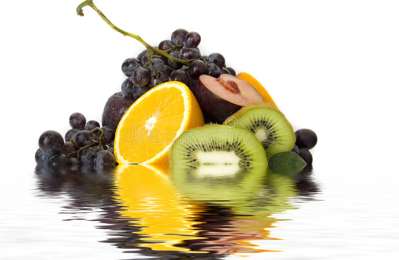 Fresh fruits reflections royalty free stock photos