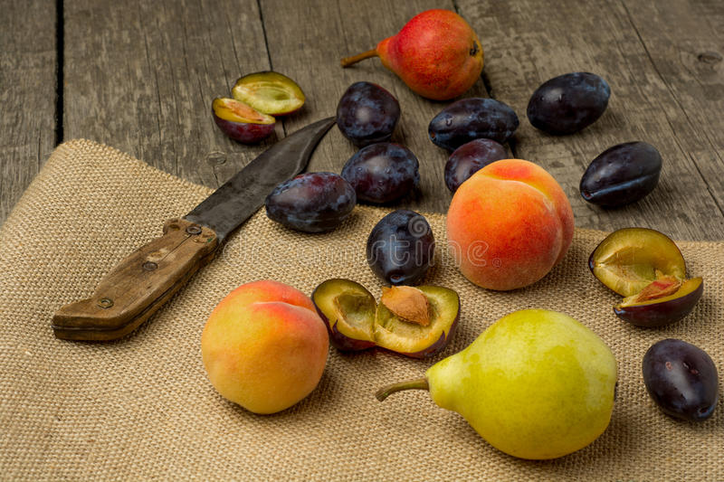 Fresh fruits on rustic wooden background: peaches royalty free stock photography