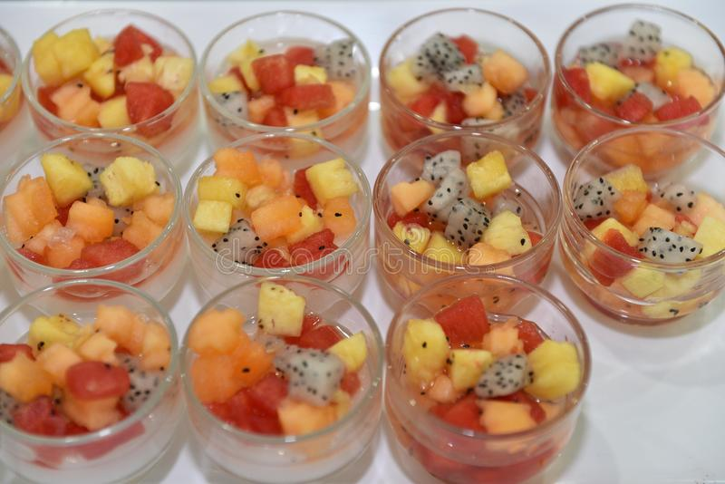 Finger food dessert : Fresh fruits salad in glass bowl royalty free stock photos