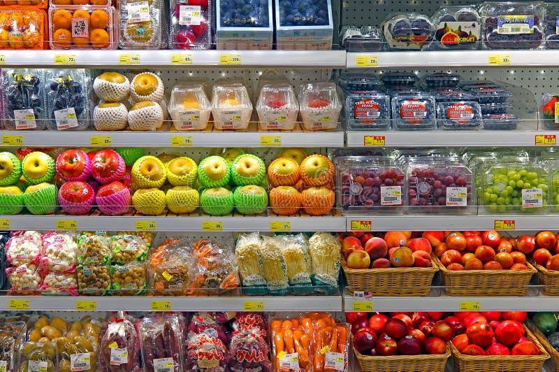 Fresh fruits at supermarket royalty free stock photos