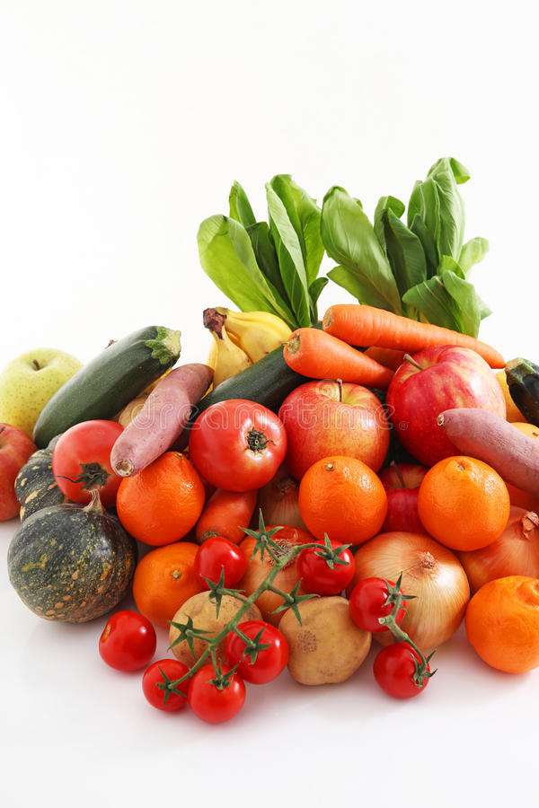 Fresh fruits and vegetables. On the dining table stock photos