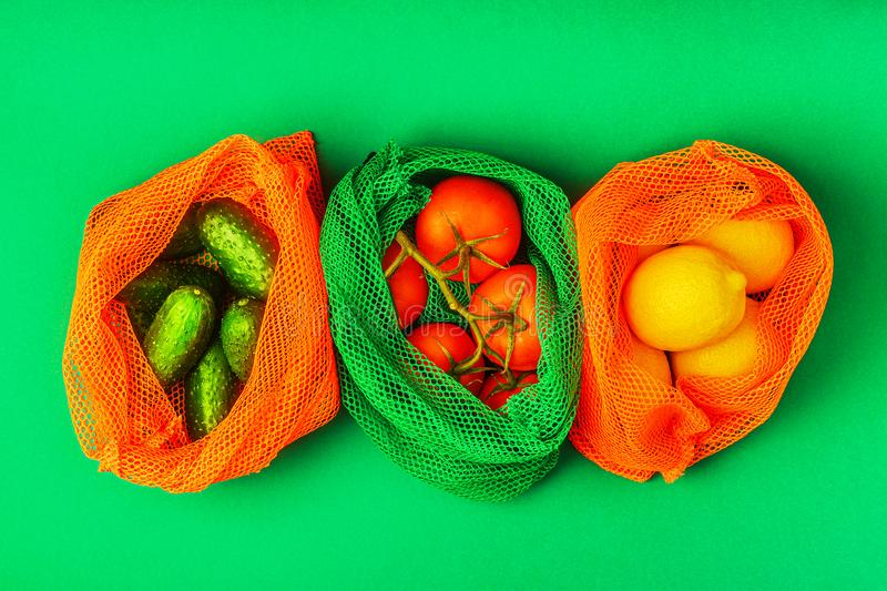 Fresh fruits and vegetables in reusable textile mesh bags stock photography