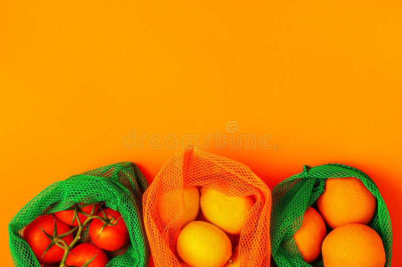 Fresh fruits and vegetables in reusable textile mesh bags stock photos