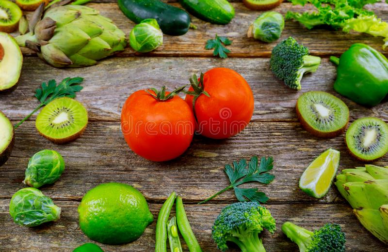Fresh fruits and vegetables on wood table royalty free stock images