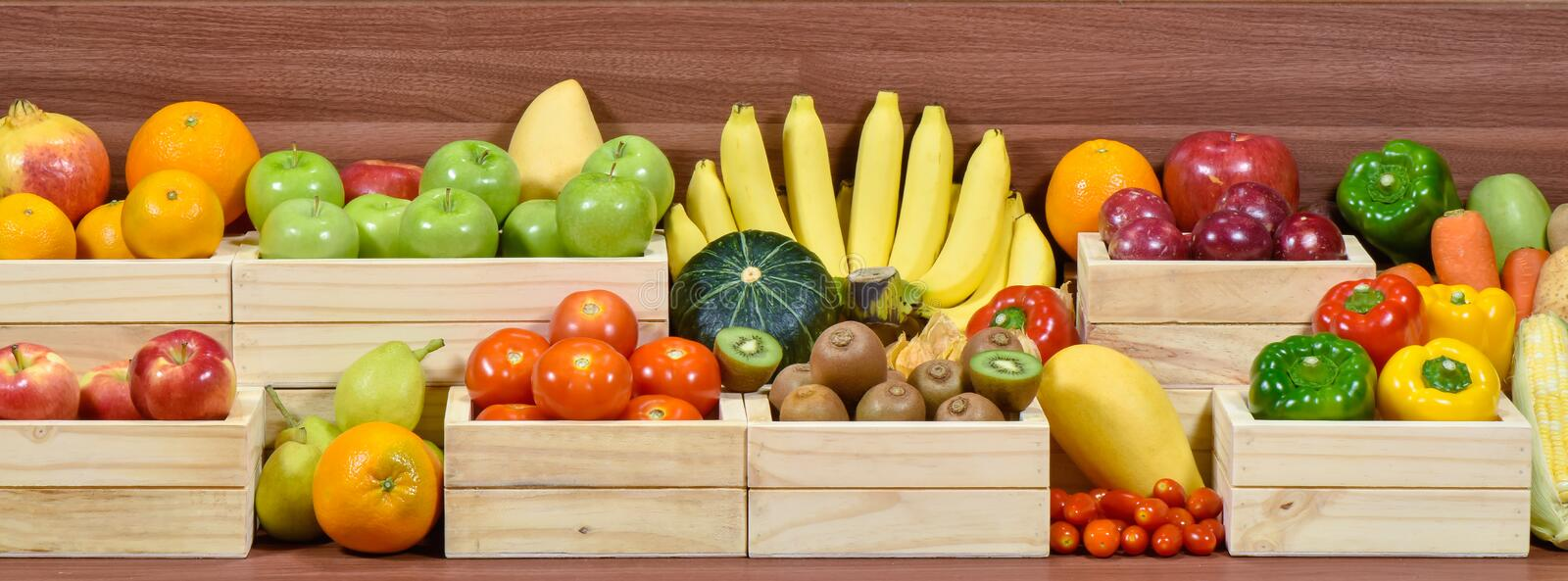 Fresh fruits and vegetables in woodem box stock photography