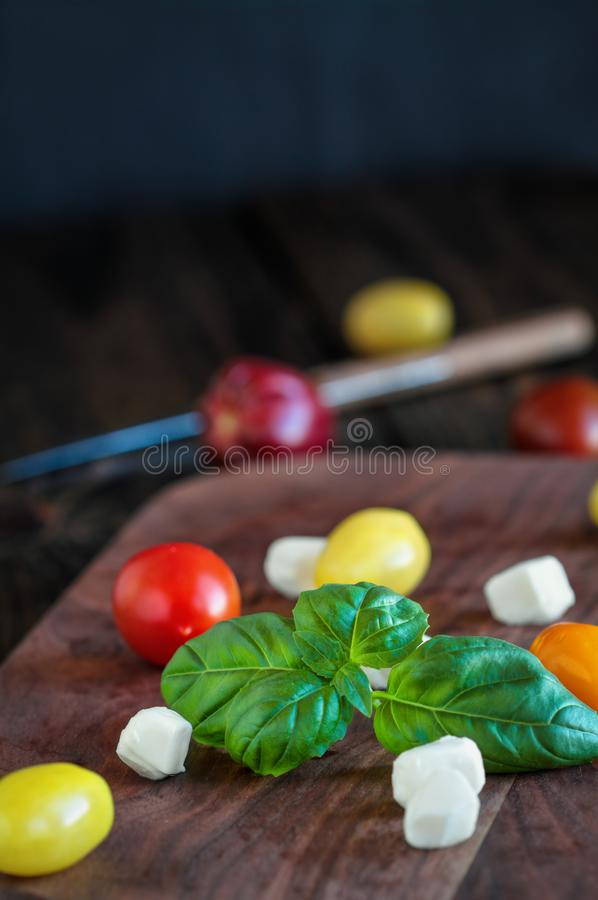 Fresh Garden Basil and Heirloom Tomatoes with Mozzarella Cheese for Caprese Salad stock photo