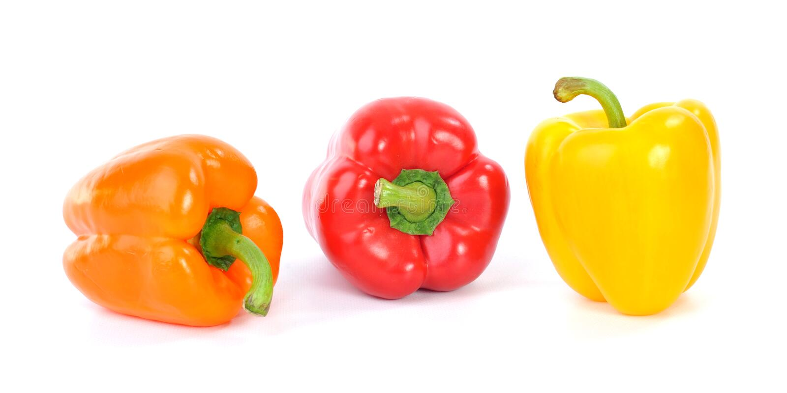Yellow, Orange and Red Bell Peppers royalty free stock image