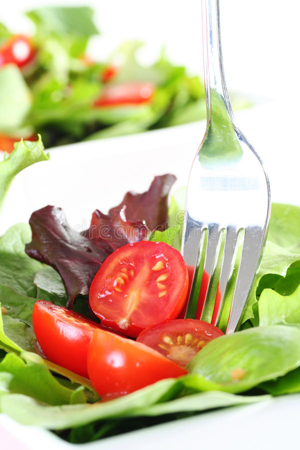 Fresh garden salad. With fork stock images