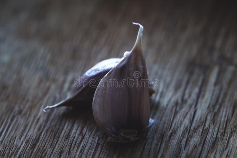 Fresh Garlic. Garlic bulbs on a black background. Close up. Selective focus stock photos
