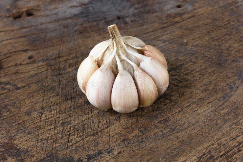 Fresh garlic on wooden background stock image