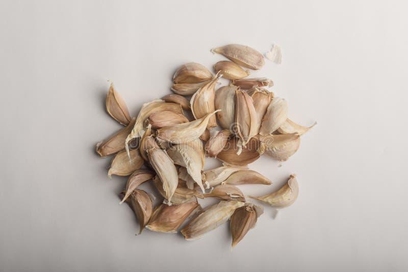 Fresh garlic on white background. Fresh garlic cloves on a white background royalty free stock image