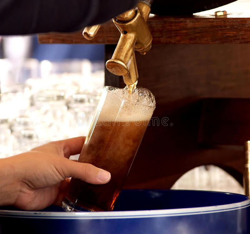Fresh german draft beer. Famous top-fermented dark beer in duesseldorf, germany royalty free stock photos