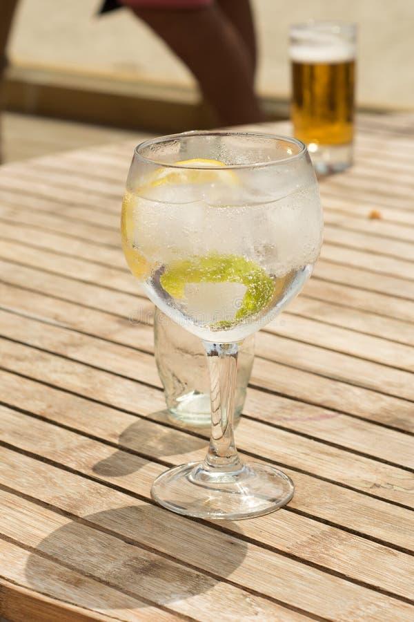 Fresh gin tonic at the beach royalty free stock image