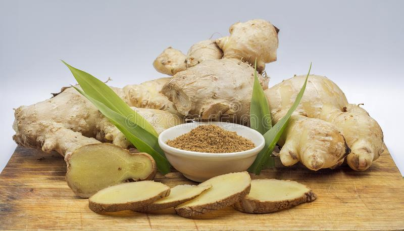 Fresh ginger root and ginger power royalty free stock image