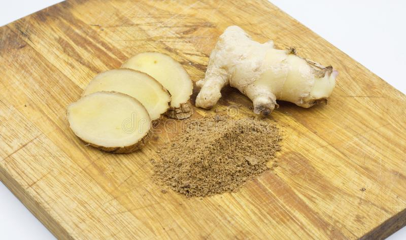 Fresh ginger root and ginger power with sliced giner royalty free stock images