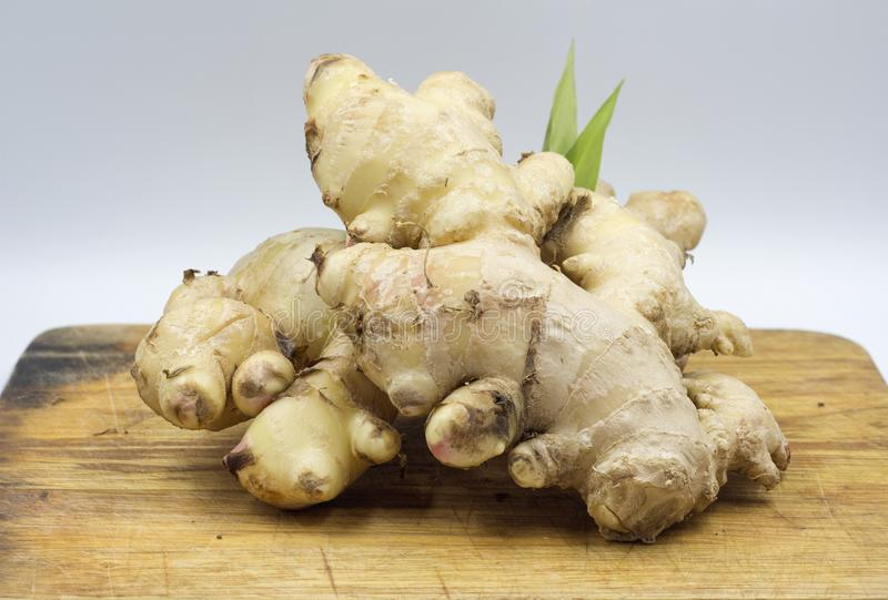 Fresh ginger root with leaf stock images
