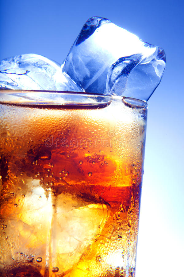 A fresh glass of cola with ice stock photo
