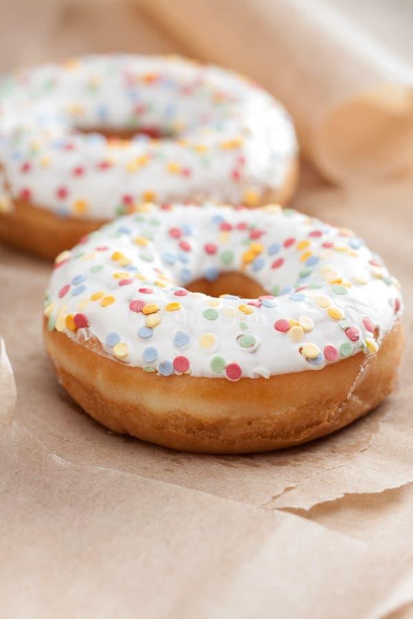 Fresh glazed doughnut with sprinkles royalty free stock images