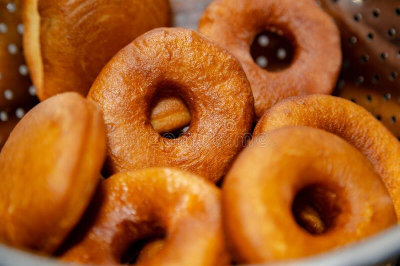 Fresh, golden brown and homely cooked Donuts. Focused and defocused on donuts. Home made sweet dish stock photography