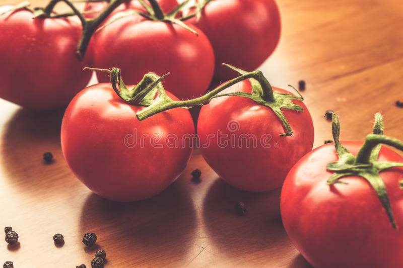 Fresh grape tomatoes with spices for use as cooking ingredients. Healthy eating. stock image