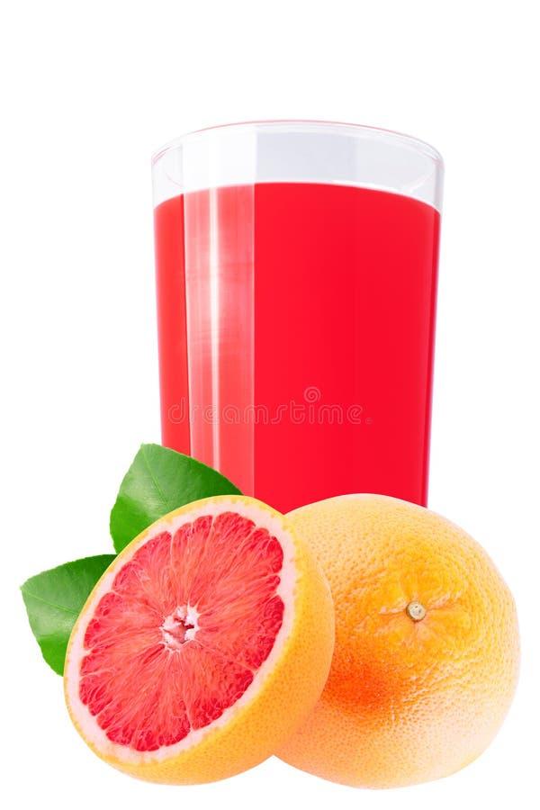 Fresh grapefruit juice isolated on white. Isolated citrus juice. Glass with fresh grapefruit juice and cut fruits isolated on white background stock photos