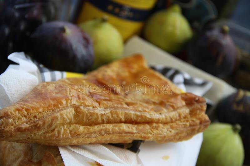 Fresh Greek cheese pie. Cheese pie and fresh figs on plate stock photo