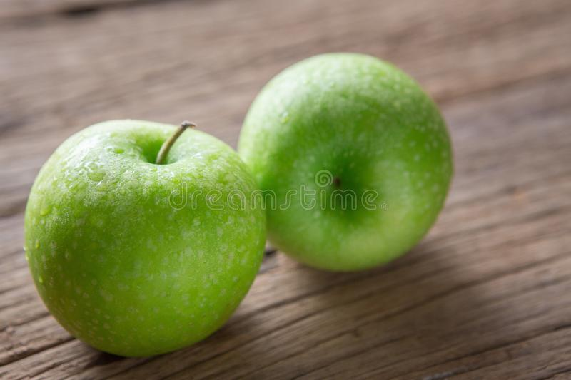 Fresh Green Apple on Wood royalty free stock photography