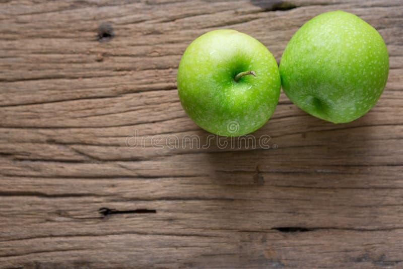 Fresh Green Apple on Wood stock photos