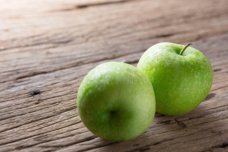 Fresh Green Apple on Wood royalty free stock image