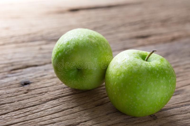 Fresh Green Apple on Wood stock images