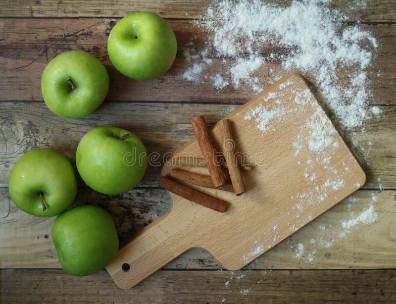 Fresh Green Apples With Cinnamon Sticks royalty free stock image