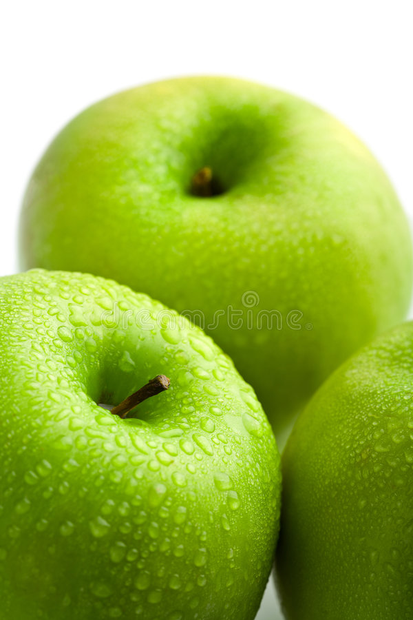 Fresh green apples with water droplets isolated royalty free stock images
