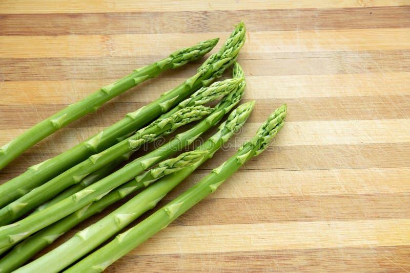 Fresh green asparagus on a cutting board stock photography
