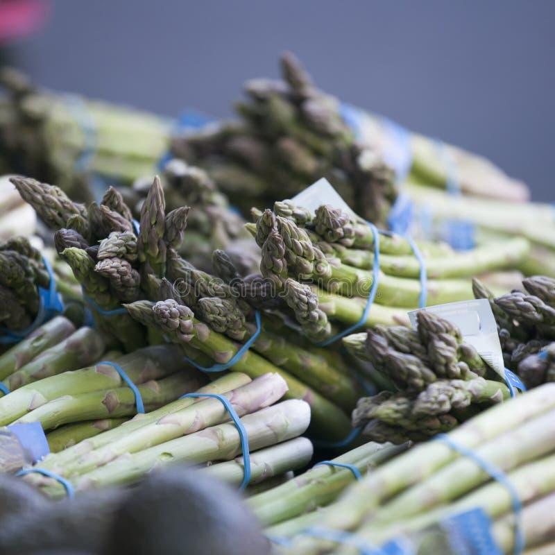 Fresh green asparagus. Farmer`s Market. Gray background stock photography
