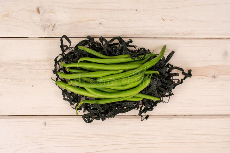 Fresh green bean on grey wood royalty free stock photo
