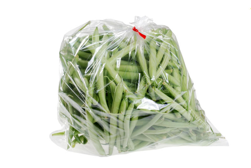Fresh green beans in a bag. Isolated fresh green beans in a bag on white background stock photos