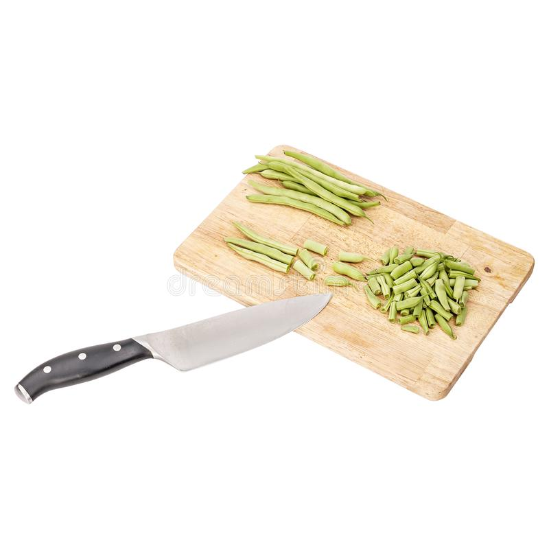 Fresh green beans on a cutting board on a table, white isolated royalty free stock photo