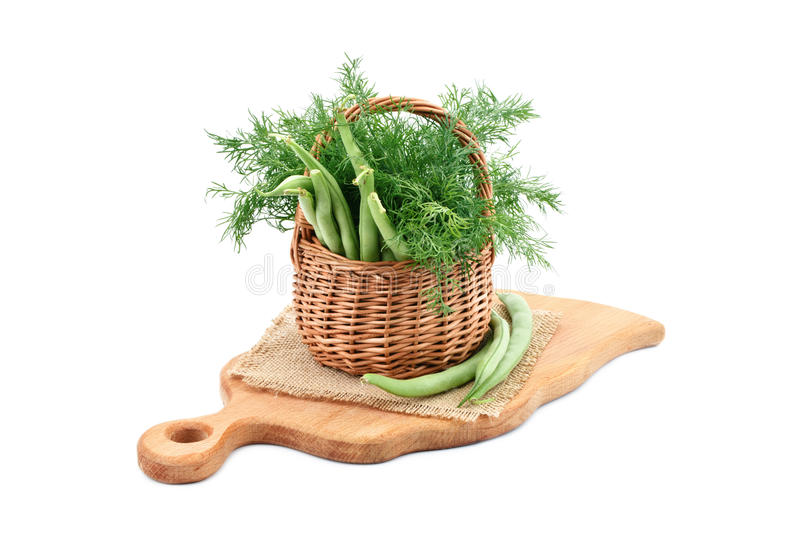 Fresh green beans and dill on a cutting Board. royalty free stock photo