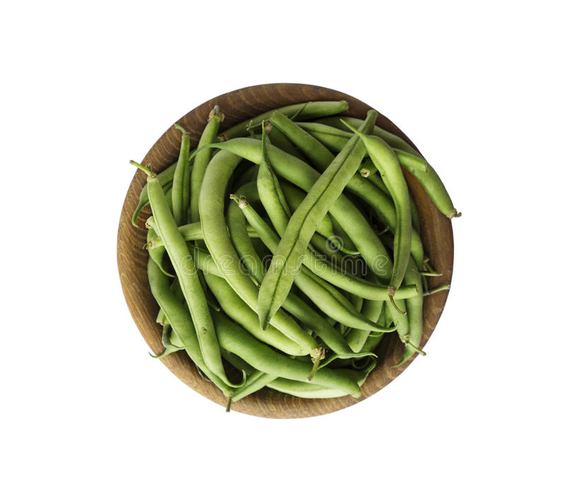 Fresh green beans in wooden bowl isolated on white background stock photography