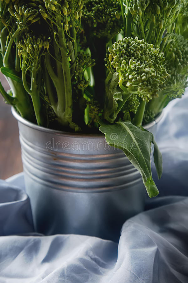 Fresh green broccoli in a metal plate. Dark wood background. Spa stock photography