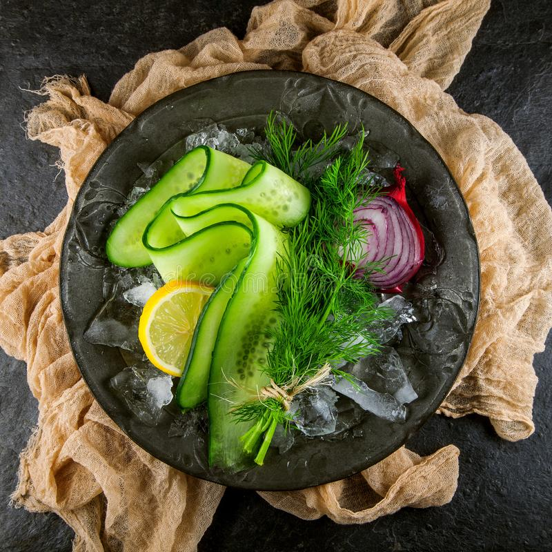 Fresh green cucumber with red onions and dill herbs stock photos