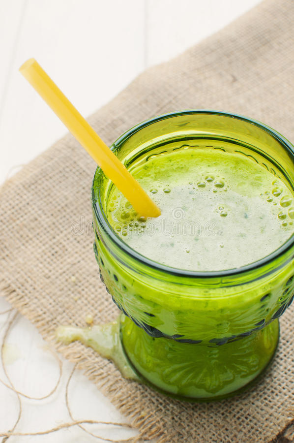 Download Fresh Green Juice On Rustic Table Stock Photo - Image: 27052182