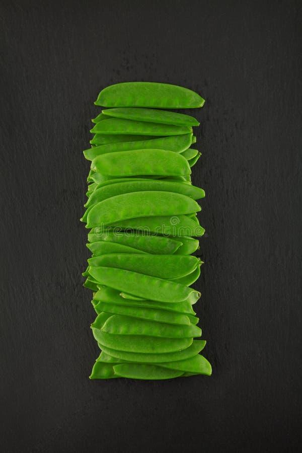 Fresh green kaiser peppers on dark slate kitchen plate, rusty shabby chic stock images