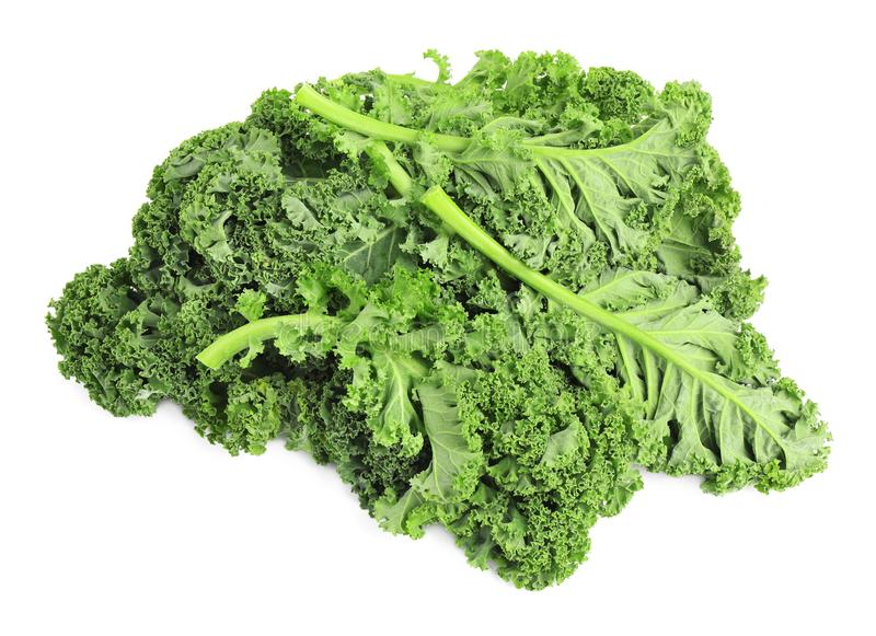 Fresh green kale leaves isolated on white. Fresh green kale leaves isolated stock photo