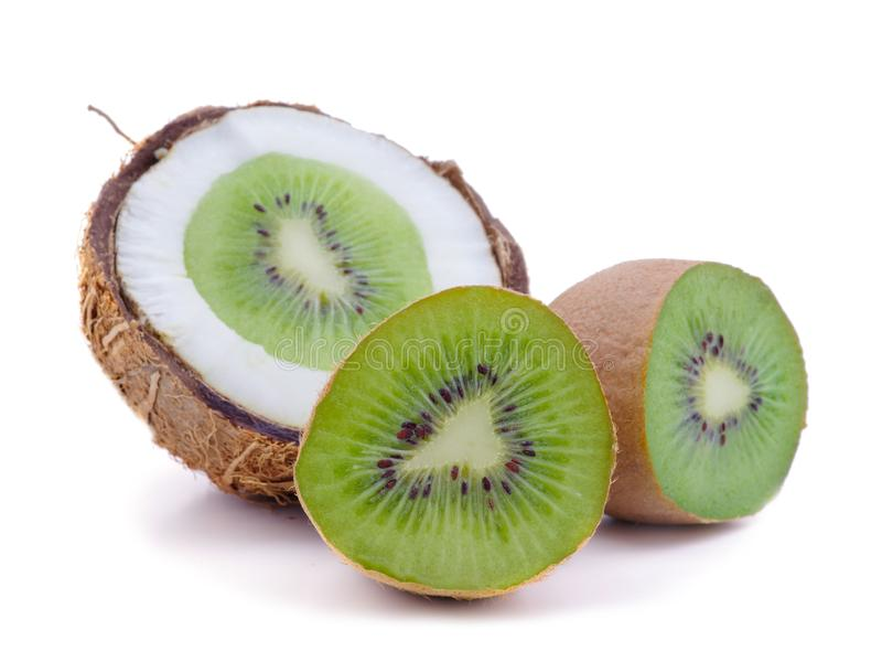 Fresh green kiwi fruit and coconut close up isolated on white background with selective focus stock photos