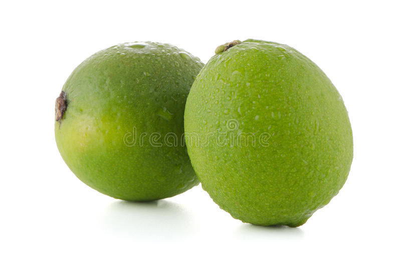 Fresh green limes. On white background stock image