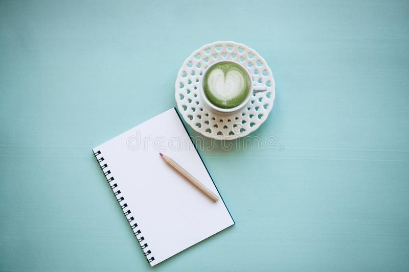 Fresh green Matcha coffee with a heart pattern royalty free stock photos