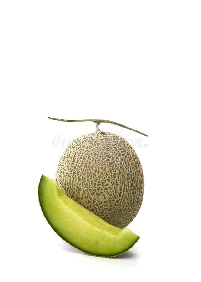 Fresh green melon and slice on white royalty free stock photo