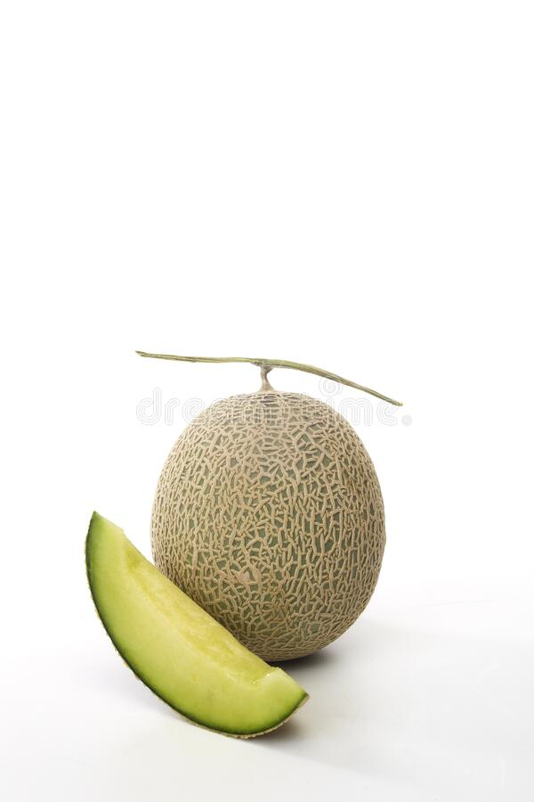 Fresh green melon and slice on white royalty free stock photography